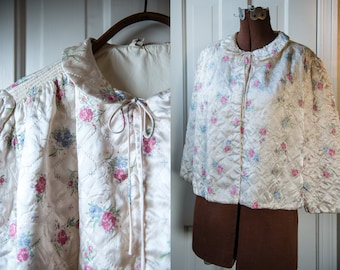Vintage 1950s quilted satin bed jacket with blue and pink roses motif and Peter Pan collar | The Stella Fagin | Size L
