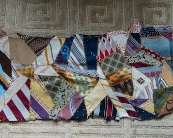 "Vintage 1950s handmade crazy quilt section made from mens neckties and assembled with hand feather stitching | 13"" x 28"""