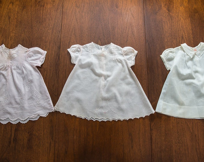 Lot of 3 vintage 1950s cotton baby doll dresses with embroidery and scalloped edges