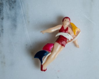 "Vintage 1950s plastic nautical themed pin-up bathing beauty with bathing cap pin | made in Japan | size 1.25"" x 2"""