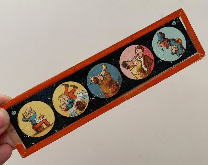 Vintage cartoon strip on glass, collectible cartoon, playful artwork
