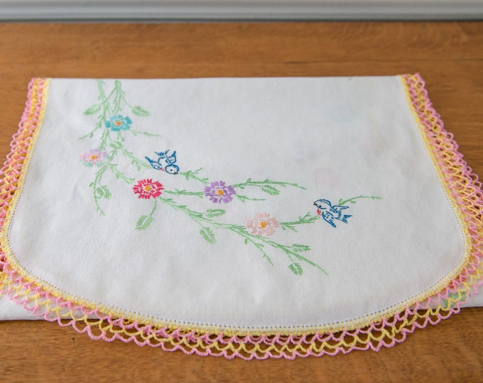 Vintage embroidered dresser scarf or table runner with blue bird and multi color flowers