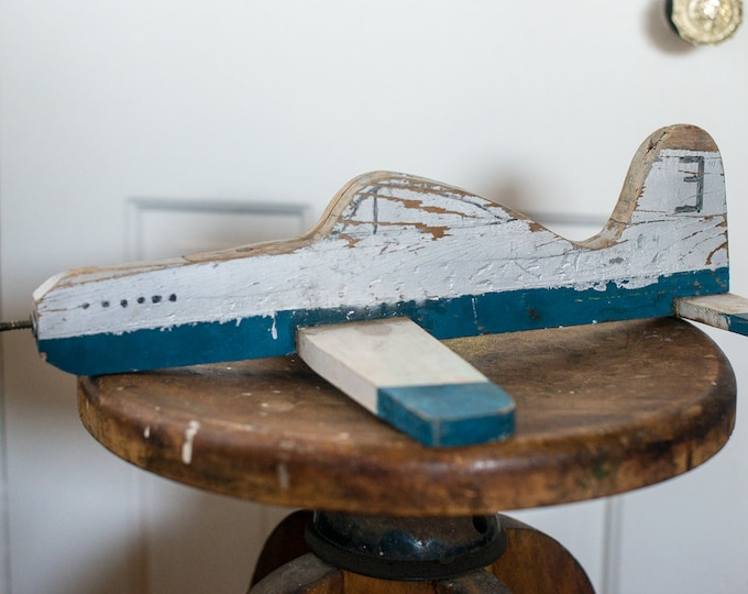 Vintage primitive and rustic hand painted wooden toy airplane
