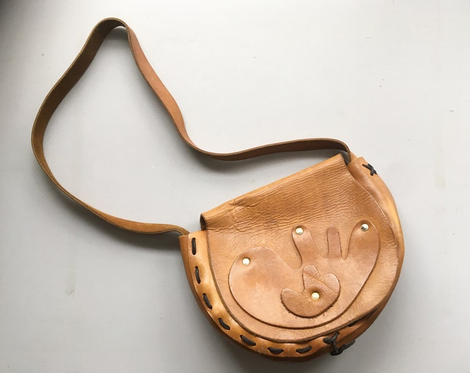 Vintage 1960s hand-laced saddle leather bag with abstract appliques and in the hippie boho style