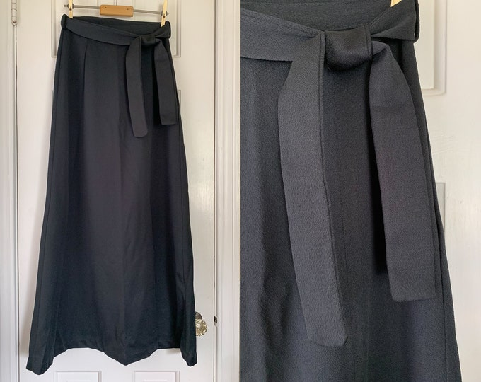 Vintage 1970s black polyester knit maxi skirt with tie belt and front kick-slit | Size XS