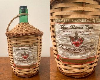 Vintage wine jug in wicker basket, Spanish wine bottle, bar or restaurant decor, Vino Blanco Cepa, Marques De Muller