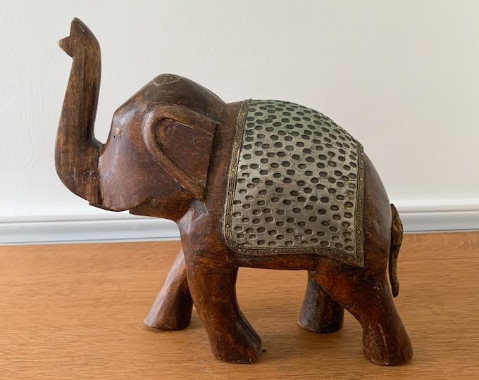 Vintage large wooden elephant with decorative metal details, boho tabletop decor
