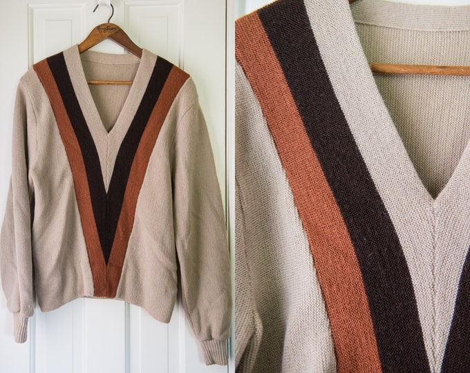 Vintage 1950s beige long sleeve v-neck sweater with light reddish brown and dark brown stripes | union made | Size M