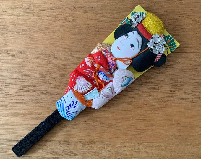 Vintage souvenir Japanese Hagoita Paddle with ornate silk geisha decoration