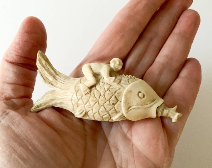 Vintage carved white fish shaped snuff box or bottle with man riding the fish