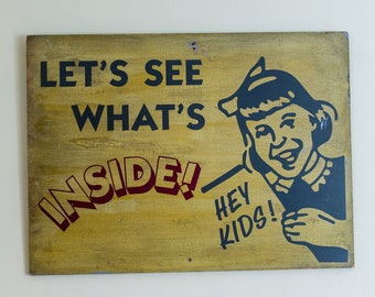 "Authentic vintage 1950s wooden advertising sign ""Hey kids! Let's see what's inside!"""