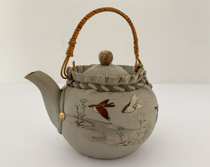 Vintage small artisan made pottery teapot with swallow and floral lily decoration, handmade teapot