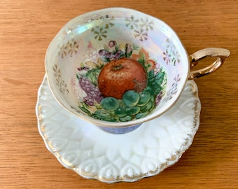 Vintage transfer-ware footed teacup and saucer with grape and pomegranate decoration, collectible teacup and saucer