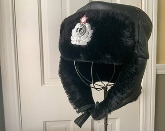 Black leather and fur ear flap trapper hat with decorative Russian red star badge
