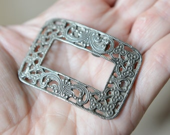 Vintage 1930s pair of ornate rectangular silver tone shoe clips, scroll work