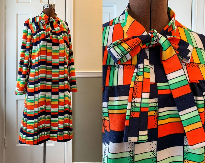 Vintage 1960s long sleeve knit secretary dress in a colorful mod geometric print, Size M