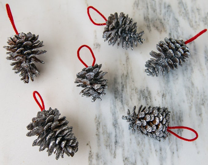 Vintage collection of 6 real pine cones hand painted silver, dusted with silver glitter with red pipe cleaner hangers