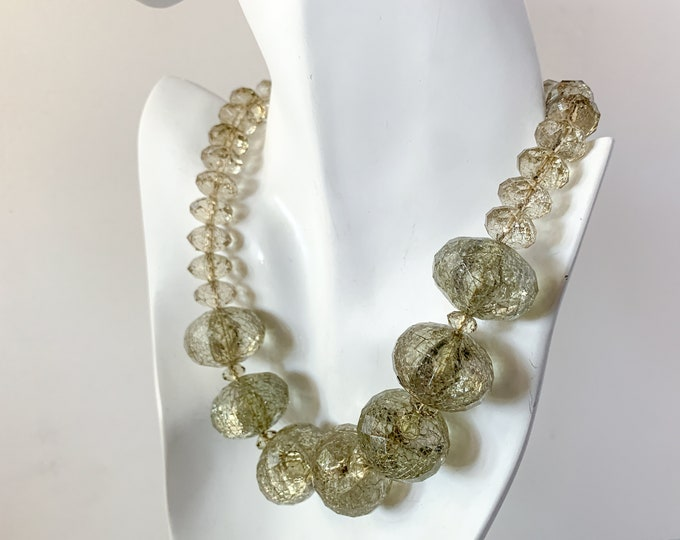 Vintage mod clear plastic graduated facetted bead necklace with floating gold tinsel