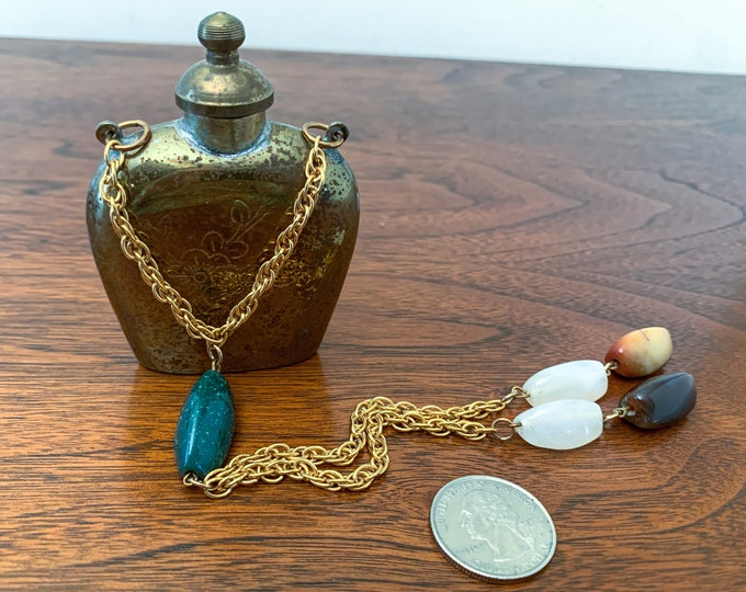 Vintage brass color snuff box with engraving and decorative chain adornment, snuff bottle with spoon