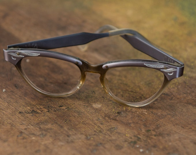 Vintage 1950s cat eye glasses in silver gray aluminum with etched leaf design | made in the USA