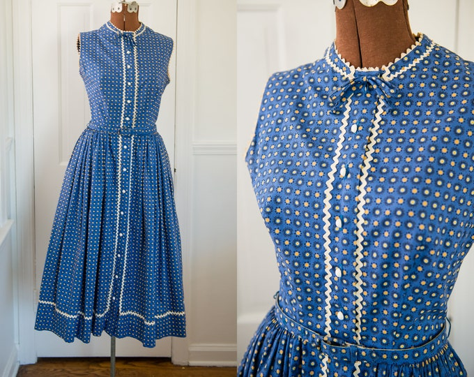Vintage 1950s blue polka dot sleeveless button-up dress with pockets and rick rack trim, Swiss-ette, Size XS/S