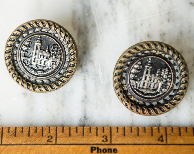 Vintage 1940s shank buttons with embossed metal castle or estate motif with ornate ribbon details