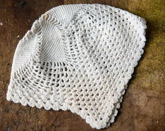 White crocheted bonnet for newborn baby or baby doll