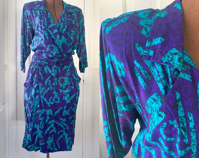 Vintage 1980s 3/4 sleeve shirtwaist career dress in purple and turquoise abstract mod print, made by Sally Lou, Size M