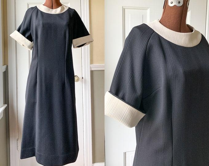 Vintage 1960s black poly knit career dress with contrasting cream banded trim, minimalist dress, Joe Barry Dallas, Size M