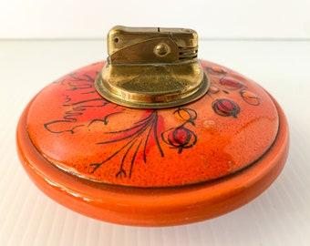 Vintage orange Sascha Brastoff enamel and pottery tabletop cigarette lighter, MCM lighter