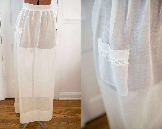 Vintage white sheer cotton full-length half apron with wide bow tie, hostess apron