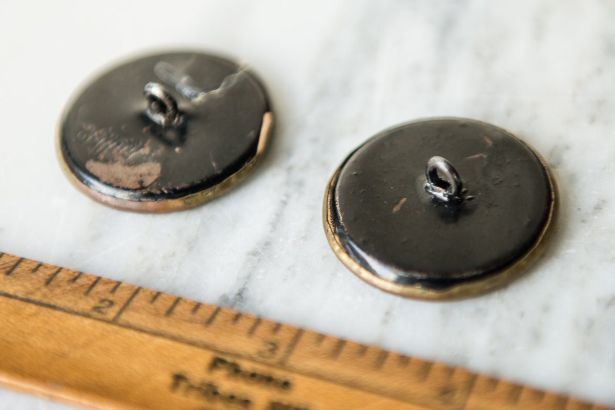 Vintage 1940s shank buttons embossed with metal castle motif