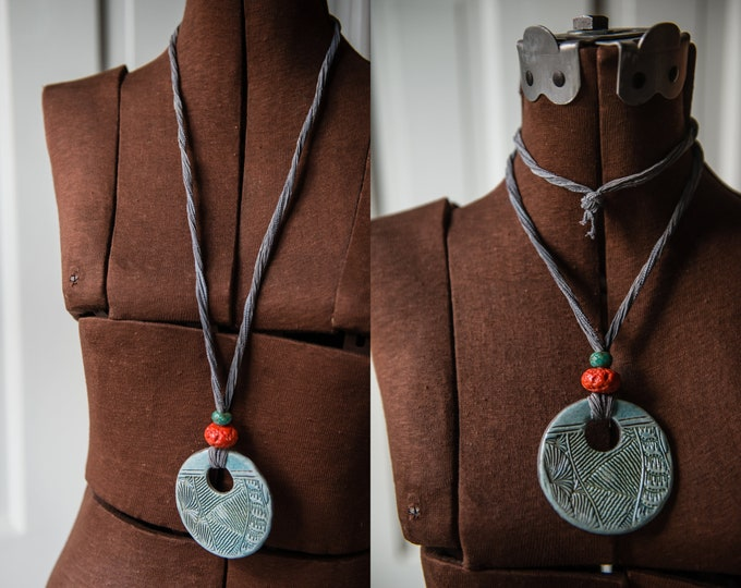 Handmade necklaces with pottery medallions, african trade beads and kimono fabric cords