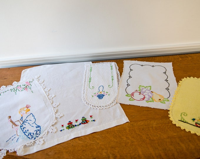 Vintage 5pc collection of linen embroidered dresser scarves, doilies, hand towel