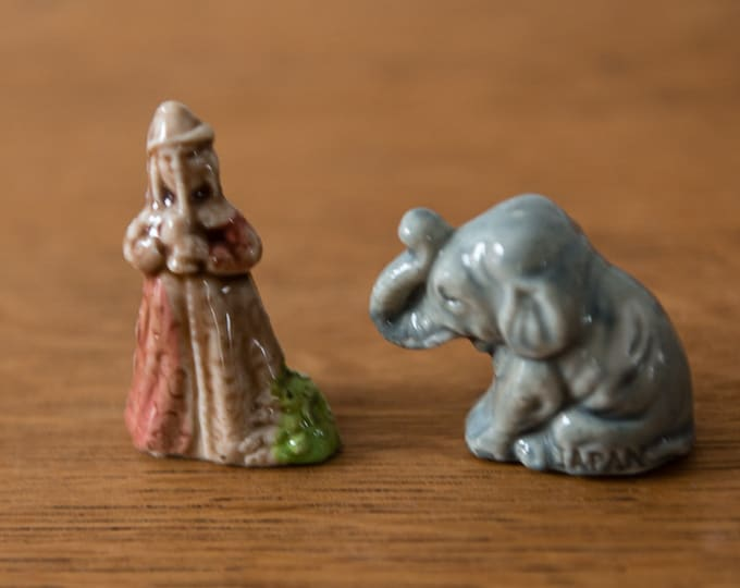 Vintage 2pc miniature elephant and man playing horn, made in Japan
