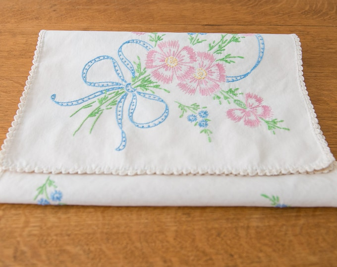 Vintage embroidered dresser scarf or table runner with blue ribbon and pink flower bouquet