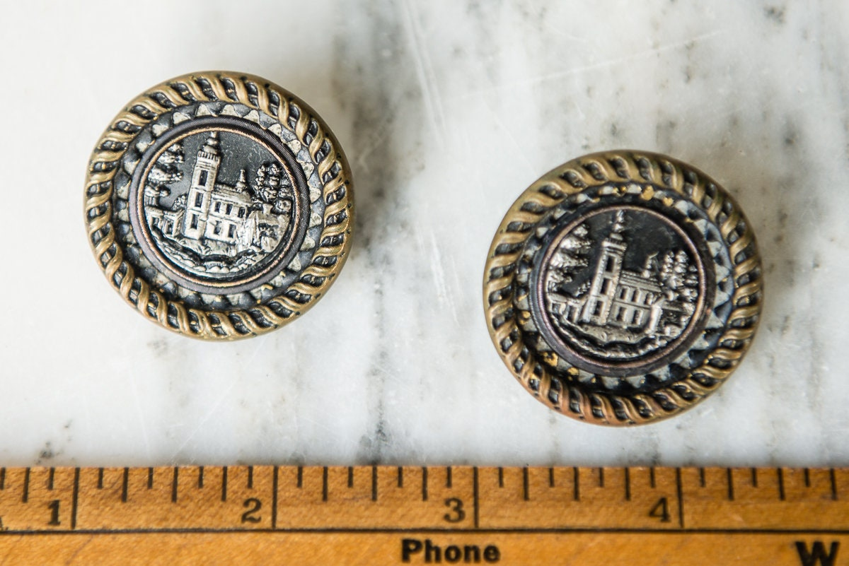 Vintage 1940s shank buttons embossed with metal castle
