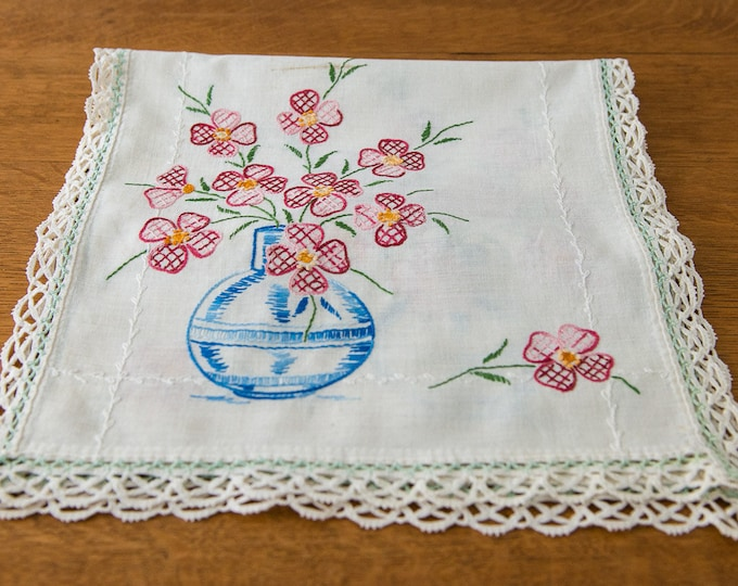 Vintage embroidered dresser scarf or table runner with vase of dogwoods