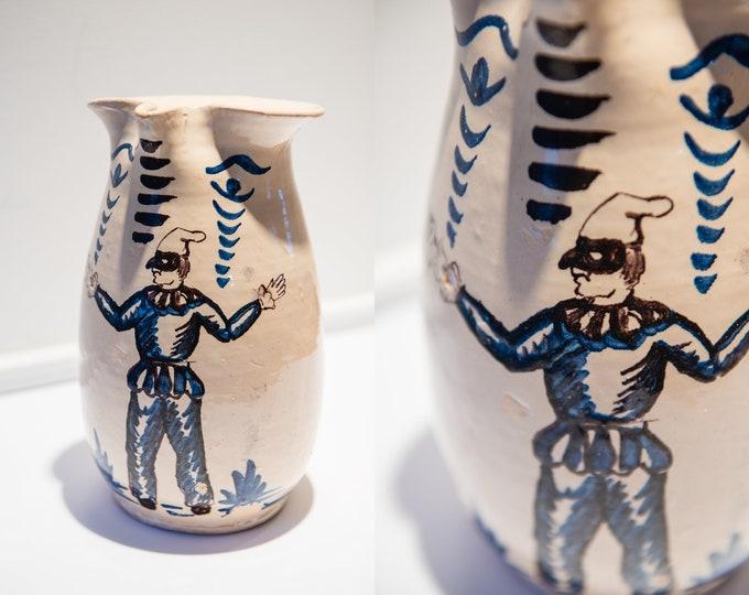 Vintage artisan-made pitcher with court jester image, studio-made ceramics