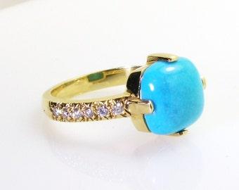 Cushion cut turquoise ring .