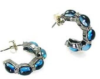 London Blue Topaz Huggie style Earrings.