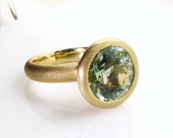 Green amethyst ring .