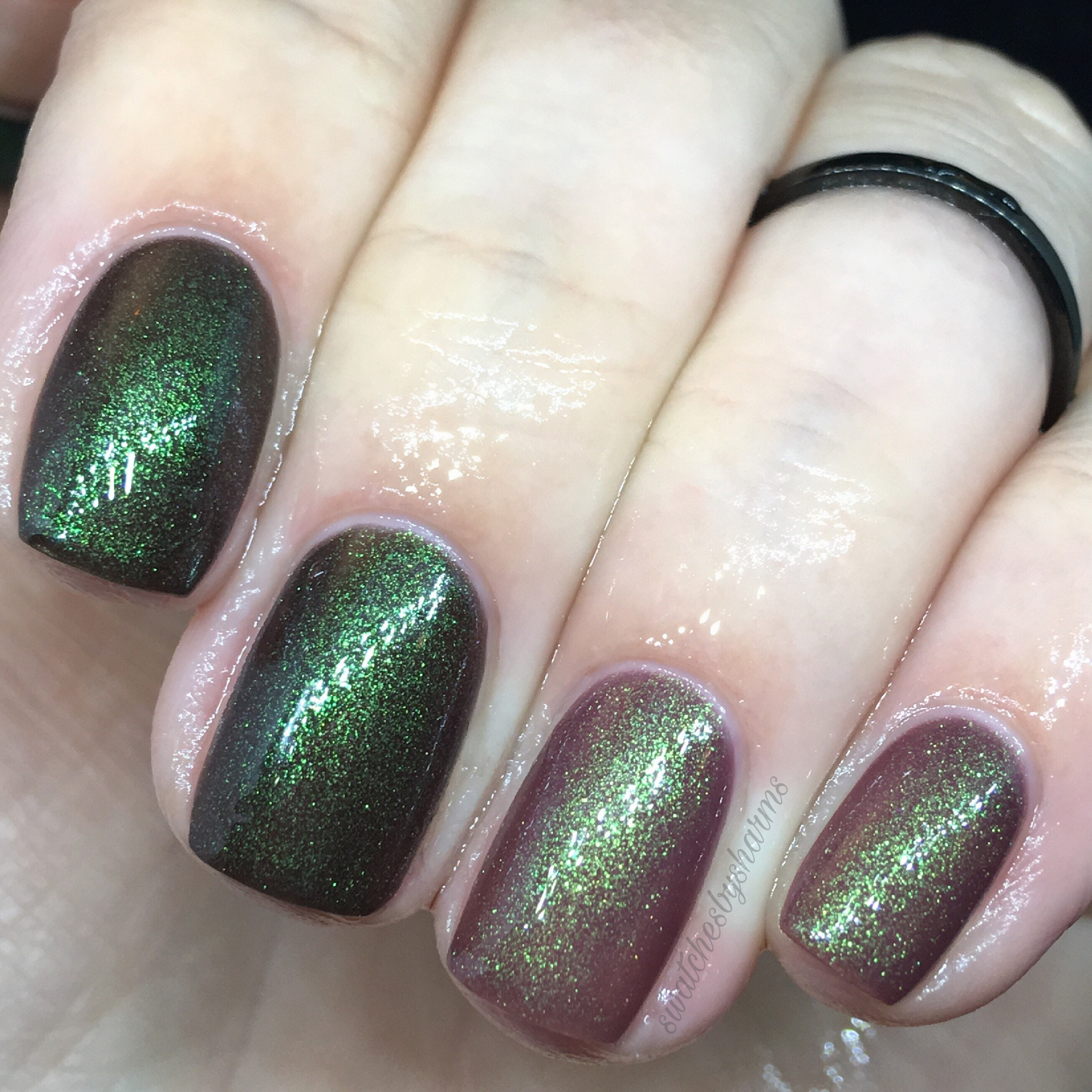 Grasp the Universe thermal black to mauve with green sparkle nail