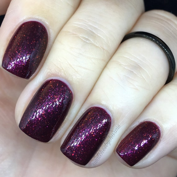 Cosmic Perspective burgundy and orange glitter nail polish Star Stuff vegan galaxy space fall sparkle