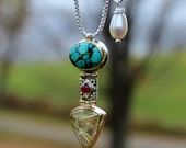 Turquoise, ruby & rutilated quartz Pendant in sterling , 14k,18k and 22k gold with freshwater pearl on 20 inch sterling silver box chain