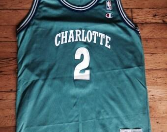Vintage NBA Charlotte Hornets Larry Johnson Champion jersey USA XL 18-20 e33a7640b