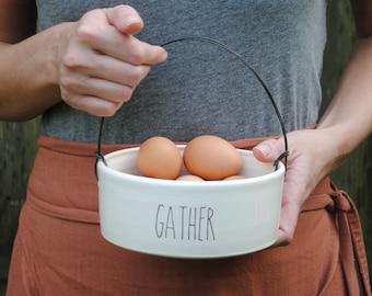 handmade white glazed wire handled ceramic basket with GATHER text under 50