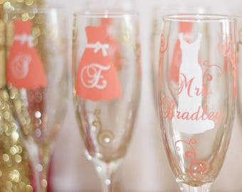 Bridesmaid dress champagne flutes glasses, name over the dress and title on the base, your choice of colors. Getting ready champagne drinks.