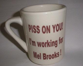 Funny BLAZING SADDLES I'm working for Mel Brooks No Stinkin Badges ceramic mug