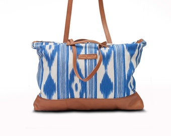 Leather and canvas shopper bag with option to convert into a backpack.